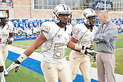Dec 1, 2012; Tulsa, Ok, USA; University of Central Florida Knights linebackers Domenic Spencer (50) and Sean Beckton (27) take the field before a game against the Tulsa Hurricanes at Skelly Field at H.A. Chapman Stadium. Tulsa defeated UCF 33-27 in overtime to win the CUSA Championship. Mandatory Credit: Beth Hall-USA TODAY Sports
