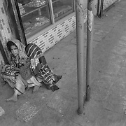 Afghan girls begging outside shops in Kandahar City, Afghanistan. Despite the amount of money invested in rebuilding Afghanistan, poverty remains one of the number one issues affecting Afghans on a daily basis. (Credit Image: © Louie Palu/ZUMA Press/The Alexia Foundation)