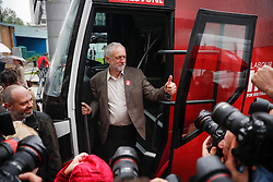 © Licensed to London News Pictures. 10/05/2016. London, UK. Labour Party leader JEREMY CORBYN poses for the media while stood in the doorway of the new Labour In For Britain campaign bus, during it's official unveiling. Alan Johnson, Chairman of 'Labour In for Britain', Labour deputy Tom Watson and Gloria De Piero, Shadow Minister for Young People and Voter Registration, also attended. Photo credit: Peter Macdiarmid/LNP