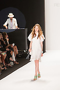 White dress with Peter Pan collar and lace insets.
