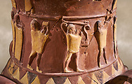Close up of the Inandik Hittite relief decorated cult libation vase decorated with relif figures coloured in cream, red and black. The processional figures include musicians and acrobats, mid to late 16th century BC - İnandıktepe, Turkey. Against a warm art background