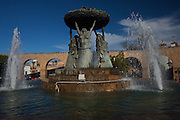 View of Fuente las Tarascas, Fountain of the Tarascas Women and the Acueducto or Aqueduct at Plaza Villalongin in Morelia, Mexico. The city is a UNESCO World Heritage Site and hosts on of the best preserved collection of Spanish Colonial architecture in the world.