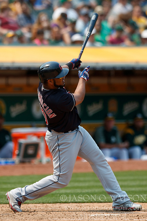 OAKLAND, CA - JULY 01: Edwin Encarnacion #10 of the Cleveland Indians hits a home run against the Oakland Athletics during the seventh inning at the Oakland Coliseum on July 1, 2018 in Oakland, California. The Cleveland Indians defeated the Oakland Athletics 15-3. (Photo by Jason O. Watson/Getty Images) *** Local Caption *** Edwin Encarnacion