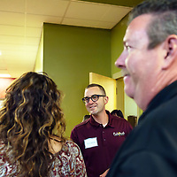 Chris VanSloothen, Rehoboth High School principle, greets parents as he walks through the open house on Friday evening in Rehoboth.