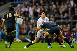 England Outside Centre (#13) Joel Tomkins (Saracens) is tackled by Argentina Inside Centre (#12) Santiago Fernandez (Bayonne) during the first half of the match - Photo mandatory by-line: Rogan Thomson/JMP - Tel: Mobile: 07966 386802 09/11/2013 - SPORT - RUGBY UNION -  Twickenham Stadium, London - England v Argentina - QBE Autumn Internationals.