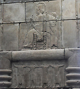 Plaster cast from Persepolis.  The image opposite is made from part of one side of a huge doorway to a palace built between 470-450 BC.  It shows the king sitting on a throne and holding a sceptre and lotus flower.  An attendant stands behind and above a richly decorated canopy.  The throne is supported by a huge platform with lion's paws and three rows of figures.  The people wear different costumes from across the Persian Empire, which stretched from Libya to India.