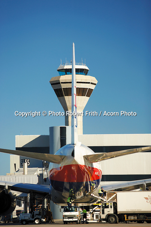 Airside on the tarmac at Perth International Airport<br /> Air traffic control tower in the background
