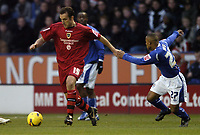 Photo: Jonathan Butler.<br />Leicester City v Cardiff City. Coca Cola Championship. 23/12/2006.<br />Ricky Scimeca of Cardiff goes past Levi Porter of Leicester.