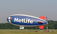 Montgomery, NY - The Me Life blimp Snoopy Two moves past members of the ground crew as it takes off from Orange County Airport in Montgomery on July 26, 2008.