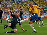 Photo: Glyn Thomas.<br /> Brazil v Australia. Group F, FIFA World Cup 2006. 18/06/2006.<br /> Brazil's Ronaldo (R) shoots under pressure from Australia's Craig Moore.