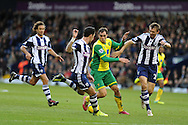 Johan Elmander of Norwich city (2nd right) looks for a gap. Barclays Premier league, West Bromwich Albion v Norwich city at the Hawthorns in West Bromwich, England on Sat 7th Dec 2013. pic by Andrew Orchard, Andrew Orchard sports photography.