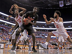 December 16, 2017 - Sunrise, FL, USA - Florida's Gorjok Gak (12) looks to shoot from under the basket in the second half against Clemson during the Orange Bowl Basketball Classic at the BB&T Center in Sunrise, Fla., on Saturday, Dec. 16, 2017. Clemson won, 71-69. (Credit Image: © Al Diaz/TNS via ZUMA Wire)