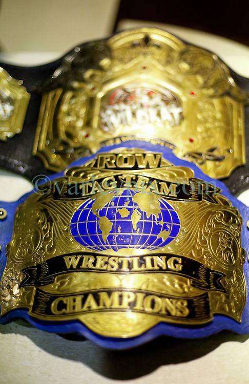 12 March 2016. Metairie, Louisiana.<br /> Wrestling action from Wildkat Sports and Entertainment's 'March into Mayhem' at the Meisler Middle School. Championship wrestling belts.<br /> Photo©; Charlie Varley/varleypix.com