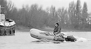 London. United Kingdom.  GBRowing coach, Mike SPRACKLEN, moves round the boats during the short race between GBM8+ Super Eight and CUBC.1987 Pre Fixture, Varsity Boat Race. National Squad vs Cambridge University BC on the Championship Course Mortlake to Putney. River Thames.  Saturday 21.03.1987<br /> <br /> [Mandatory Credit: Peter SPURRIER/Intersport images]<br /> <br /> National Squad, Bow, Terry Dillon, John MAXEY, John GARRETT, Martin CROSS, Andy HOLMES, Steve REDGRAVE, Adam CLIFT, Richard STANHOPE and Cox, Pat SWEENEY.<br /> <br /> CUBC.  Crew Bow. Ian CLARKE, Richard SPINK, Nicholas GRUNDY, Matt BRITTIN, Stephen PEEL [PRESIDENT] Jim PEW, Jim GARMAN, Paddy BROUGHTON and Cox. Julian WOLFSON 19870321 Pre Boat Race fixture, National Squard vs Cambridge UBC, London UK