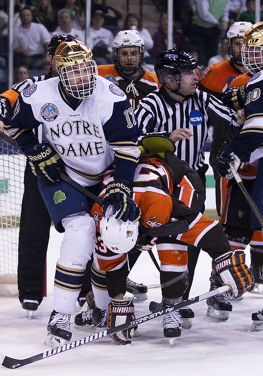 March 15, 2013:  Notre Dame left wing Nick Larson (17) and Bowling Green forward Brent Tate (23) battle in front of the net during NCAA Hockey game action between the Notre Dame Fighting Irish and the Bowling Green Falcons at Compton Family Ice Arena in South Bend, Indiana.  Notre Dame defeated Bowling Green 1-0 in overtime.