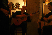 "Guitar player Jose Carvalhinho  performs every night at the restaurant ""Marques da Se"", one of the main Fado venues in Lisbon."
