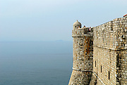 Section of old city wall jutting out into sea, Dubrovnik old town, Croatia
