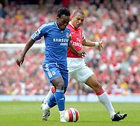 Photo: Ed Godden/Sportsbeat Images.<br /> Arsenal v Chelsea. The Barclays Premiership. 06/05/2007.<br /> Arsenal's Gilberto (R), challenges Chelsea's Michael Essien.