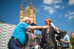 © Licensed to London News Pictures. 01/07/2019. London, UK. Sir Cliff Richard (R) huge Paul Gambaccini (L) at the launch of a campaign calling for a ban on naming sex crime suspects unless they have been charged. Photo credit: Rob Pinney/LNP