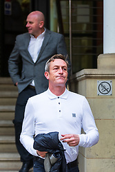 © Licensed to London News Pictures . 23/03/2021. Manchester , UK . Former Manchester United and England footballer RONNIE WALLWORK (rear) and DAVID GARNER (front) leave Minshull Street Crown Court . Garner and Wallwork were handed non-custodial sentences after previously pleading guilty to inflicting grievous bodily harm upon a man during an incident on 22nd December 2019 . Photo credit : Joel Goodman/LNP
