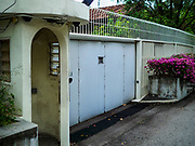 08 JULY 2017 - SINGAPORE: The gate for the family home of Lee Kuan Yew, the founder of Singapore. The home, which is more than 100 years old, has become a source of controversy in Singapore. Lee, who died in 2015, wanted the home destroyed after his death, but the current Prime Minister of Singapore, Lee Hsien Loong, has yet to have the home torn down but his siblings want to go ahead with the demolition of the home.    PHOTO BY JACK KURTZ