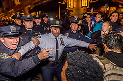 November 9, 2016 - New York, New York, United States - An estimate of ten thousand demonstrators took the streets of Manhattan on Wednesday night and converged outside Trump Tower in Midtown to protest the election of Donald J. Trump as president. As they weaved through the streets of midtown to get to Trump Tower at 57th Street and Fifth Avenue, protesters faced threats of arrest from NYPD for blocking vehicular traffic. (Credit Image: © Erik Mcgregor/Pacific Press via ZUMA Wire)
