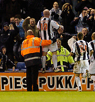 Photo: Leigh Quinnell.<br /> West Bromwich Albion v Derby County. Coca Cola Championship. 02/12/2006. A steward holds up John Hartson after his late goal for West Brom.