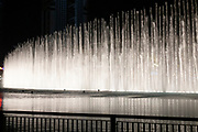 The famous Dubai Fountain water show. It is a choreographed fountain system located on the 30 acre manmade Burj Khalifa Lake.