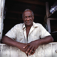 The tropical Caribbean island of Montserrat which has suffered badly since the eruption of the Soufriere Hills volcano 10 years ago. Two thirds of the island is out of bounds to everyone except scientists. Photo shows a shop owner..Photo©Steve Forrest/Workers Photos
