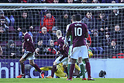 Don Cowie gets a touch on Chrispophe Berra's header to score goal in the William Hill Scottish Cup 4th round match between Heart of Midlothian and Hibernian at Tynecastle Stadium, Gorgie, Scotland on 21 January 2018. Photo by Kevin Murray.