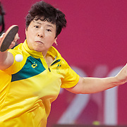 TOKYO, JAPAN - JULY 24:  Jian Fang Lay of Australia in action against Daniela Fonseca of Cuba in the Women's Singles  Preliminary Round in the Tokyo Metropolitan Gymnasium at the Tokyo 2020 Summer Olympic Games  on July 24, 2021 in Tokyo, Japan. (Photo by Tim Clayton/Corbis via Getty Images)