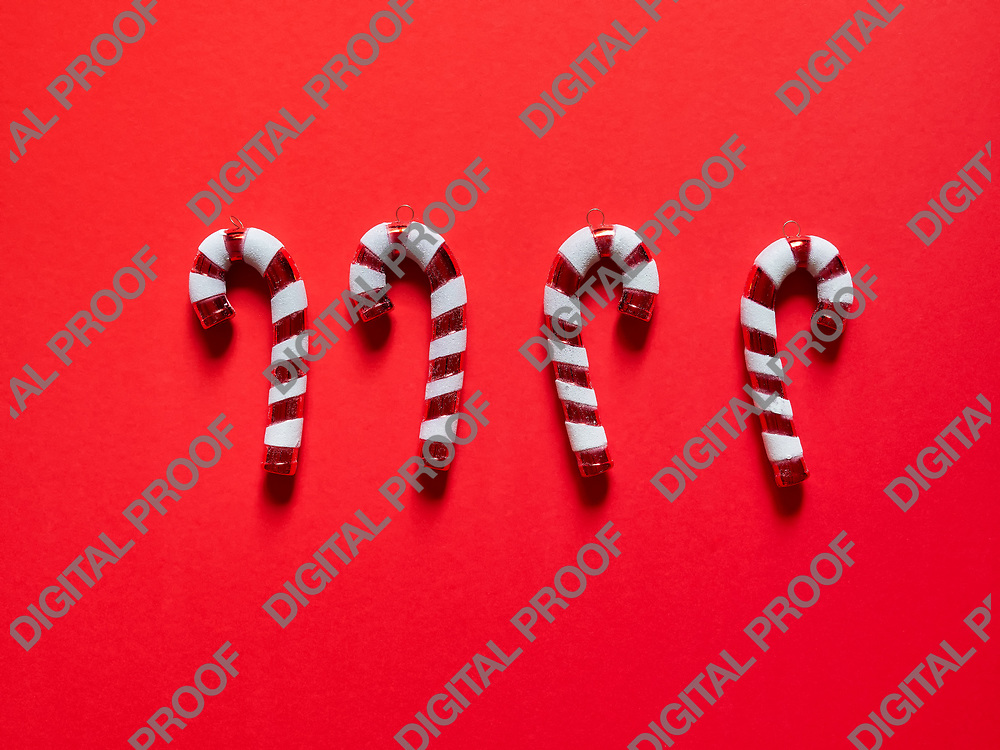 Christmas candy cane drums  at studio above view over a red background isolated flatlay