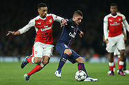 Marco Verratti of Paris Saint-Germain holds off Francis Coquelin of Arsenal. UEFA Champions league group A match, Arsenal v Paris Saint Germain at the Emirates Stadium in London on Wednesday 23rd November 2016.<br /> pic by John Patrick Fletcher, Andrew Orchard sports photography.