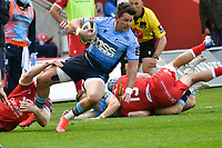 Rugby Union - 2021 Guinness Pro14 Rainbow Cup - Northern Section - Scarlets vs Cardiff Blues - Parc-y-Scarlets<br /> <br /> Jason Harries Cardiff Blues tackled by Johnny McNicholl Scarlets<br /> <br /> COLORSPORT/WINSTON BYNORTH