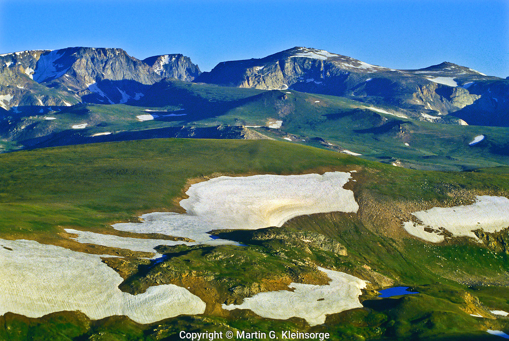 Snow fields the alpine tundra on the Beartooth Plateau of the Beartooth Mountains, Wyoming.