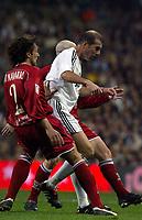 4/2/2004 Madrid, Spain.<br />Copa Del Rey (Spanish Cup) Semifinals. 1 Leg.<br />R.Madrid 2 - Sevilla 0<br />R.Madrid's Zidane (R) in duel with Sevilla's Javi Navarro (L) and Torrado (Back) at Santiago Bernabeu's Stadium.