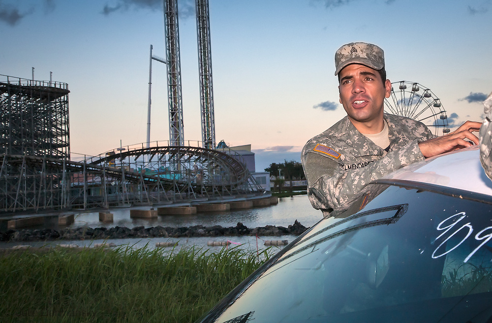 August, 24, 2008, A member of the Louisiana National Guard across from  Six Flags Amusement Park in Eastern New Orleans, destroyed by Hurricane Katrina. 2008, Roller Coaster at Six Flags Amusement Park in Eastern New Orleans, destroyed by Hurricane Katrina.