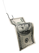 A 100 dollar bill on a fishing hook isolated can be a symbol for the elusive billable hour or money.