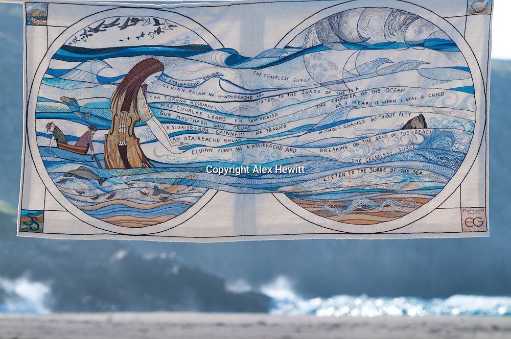 The final panel in the Great Tapestry of Sotland on the beach at Cliff near Uig on Lewis. Photographed while on tour for the Great Tapestry of Scotland project. www.scotlandstapestry.com<br /> <br /> pictures by Alex Hewitt