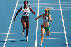 Merlene Ottey of Slovenia and Ailis McSweeney of Ireland compete during  the 4x100m Womens Relay Heats during day five of the 20th European Athletics Championships at the Olympic Stadium on July 31, 2010 in Barcelona, Spain.  (Photo by Vid Ponikvar / Sportida)