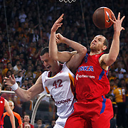 Galatasaray MP's Boris Savovic (L) and CSKA Moscow's Ramunas Siskauskas (R) during their Euroleague Top 16 basketball match Galatasaray MP between CSKA Moscow at the Abdi Ipekci Arena in Istanbul at Turkey on Thursday, February, 09, 2012. Photo by TURKPIX