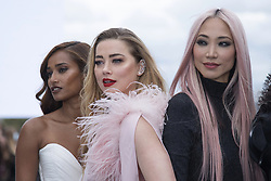 Nidhi Sunil, Amber Heard and Soo Joo Park posing on the runway after the L'Oreal show as part of Paris Fashion Week Womenswear Spring/Summer 2022 in Paris, France on October 03, 2021. Photo by Aurore Marechal/ABACAPRESS.COM