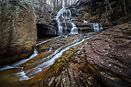 The lower falls of Fern Creek in the New River Gorge of West Virginia cascade off the layered sandstone rock formations.