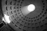 The sun illuminates the inside of the ceiling through the hole at the top of the Pantheon in Rome, Italy