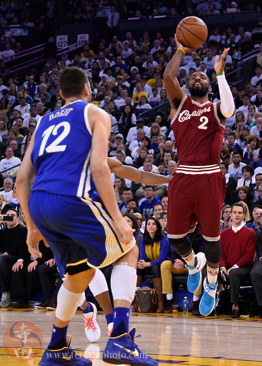 Dec 25, 2015; Oakland, CA, USA; Cleveland Cavaliers guard Kyrie Irving (2) shoots against Golden State Warriors center Andrew Bogut (12) in the first half of a NBA basketball game on Christmas at Oracle Arena.