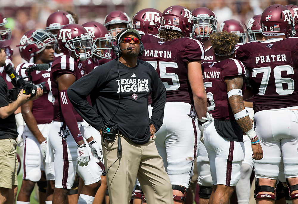 Texas A&M head coach Kevin Sumlin watches a replay on the scoreboard during a timeout against Louisiana-Lafayette during the first quarter of an NCAA college football game Saturday, Sept. 16, 2017, in College Station, Texas. (AP Photo/Sam Craft)