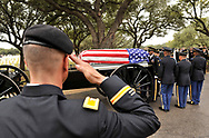 Slug: Haines buried-Photo Request 55796-December 3. 2011-San Antonio, Texas---Colonel William Hill salutes the casket of General Ralph Haines during his burial with full militry honors at Ft. Sam Houston National Cemetary Saturday.