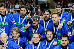 Players of Slovenia celebrate after the ice hockey match between National Teams of Austria and Slovenia in 5th Round of 2016 IIHF Ice Hockey World Championship Division 1 - Group A, on April 29, 2016 in Spodek Arena, Katowice, Poland. Photo by Marek Piuyzs / Sportida