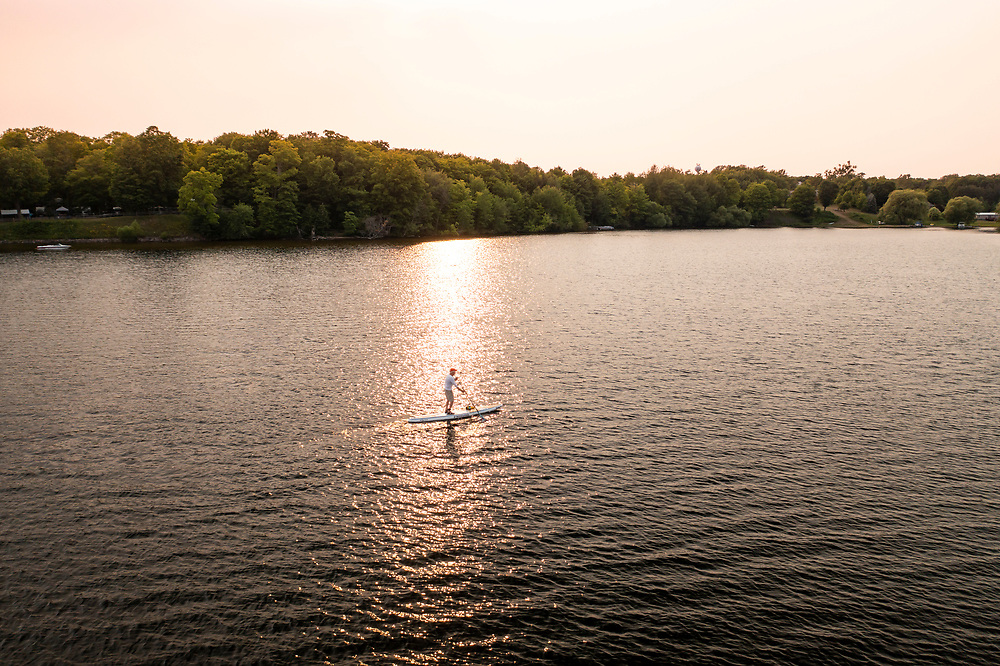 Aerial view of paddleboarding on Lake Independence in Big Bay, Michigan.