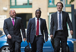 © London News Pictures. 10/09/2012. London, UK . Kweku Adoboli (centre) arriving at Southwark Crown Court in London on September 10, 2012 where he is charged with charged with fraud by abuse of position and false accounting.  Adoboli is accused of undertaking unauthorised trading at Swiss bank UBS that resulted in a $2bn loss for the bank, one of the biggest ever cases of alleged unauthorised trading. Photo credit: Ben Cawthra/LNP